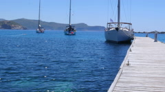 Yacht at wooden pier, knidos, datca, turkey Stock Footage