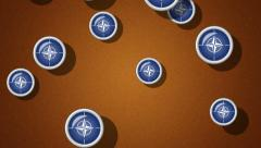 Flying flagged icons of NATO. Looping. Alpha channel is included. Stock Footage
