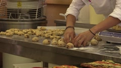Baker at work forming the dough for italian regional goodies bakery Stock Footage