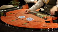 Gamble players at casino, gambling roulette poker game table Stock Footage