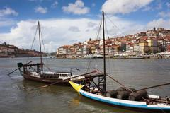 Boats with Wine Barrels on Douro River in Porto - stock photo