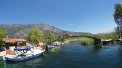AZMAK RIVER, AKYAKA - TURKEY: People on bridge Stock Footage