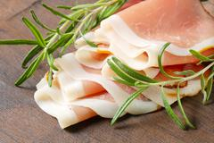 Delicious dry-cured ham sliced paper thin - stock photo