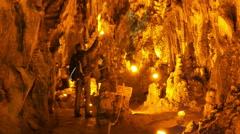 MENCILIS CAVE, SAFRANBOLU, TURKEY: tourist group travel stalactite Stock Footage