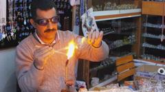 SAFRANBOLU, TURKEY: Glass blowing man working Stock Footage