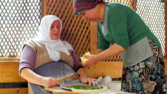 SAFRANBOLU, TURKEY: women preparing traditional food, gozleme Stock Footage