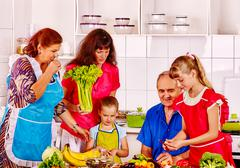 Happy family  with child and grandparent cooking at kitchen - stock photo