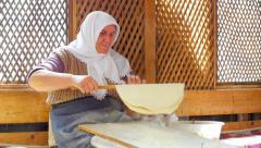 SAFRANBOLU, TURKEY: woman preparing traditional food, gozleme Stock Footage
