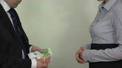 Man count euro salary and give woman in hand. 4K Stock Footage