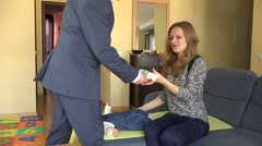 Man leave cash banknotes for woman with baby. 4K Stock Footage