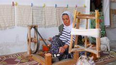 FETHIYE, TURKEY: turkish woman weaving loom machine Stock Footage