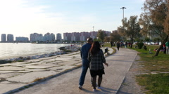 KARSIYAKA, IZMIR, TURKEY: people enjoy seaside garden Stock Footage
