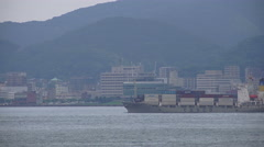 Cargo Ship Coastal City and Mountains Shimonoseki Japan 02 Stock Footage