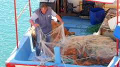 SIGACIK, SEFERIHISAR, TURKEY: Fishermen working Stock Footage