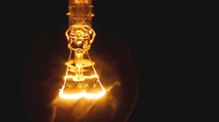 Light bulb gradually turns on and off - stock footage