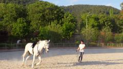 AKYAKA - TURKEY: stableman warming up horse riding Stock Footage