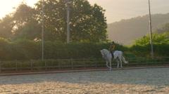 AKYAKA - TURKEY: dressage, horse show rider girl, sunset Stock Footage
