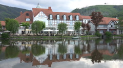 Harz village Ilsenburg with swan lake and gastronomy Stock Footage