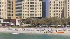 Summer time dubai marina  jbr crowded beach 4k uae Stock Footage