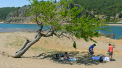 IZTUZU TURTLE BEACH, DALYAN, TURKEY: people enjoy Stock Footage