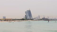 Hot day light dubai famous hotel beach 4k uae Stock Footage