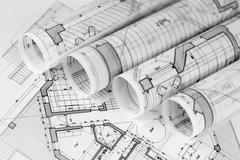 Rolls of architecture blueprints & house plans Stock Photos