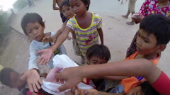PHNOM PENH, CAMBODIA: Charity donation to poor kids Stock Footage