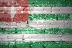 painted abkhazian flag on a wooden texture - stock photo