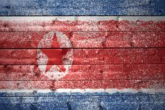 Painted north korea flag on a wooden texture Stock Photos