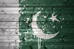 painted pakistani flag on a wooden texture - stock photo