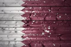 painted qatar flag on a wooden texture - stock photo