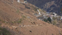 Hikers walking on hike trail of Tiger Leaping Gorge - stock footage
