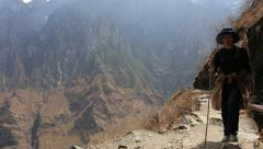 Woman walking on hike trail of Tiger Leaping Gorge - stock footage
