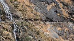 Hiking woman resting during trekking along Tiger Leaping Gorge Stock Footage