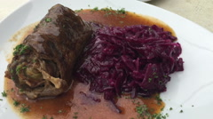 Freshly cooked rolled meat with red cabbage Roulade und rote Beete Stock Footage