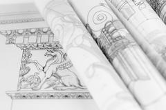 rolls of architecture blueprints & house plans - stock photo