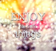 Enjoy the little things words on defocus background - stock photo