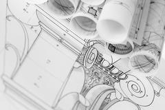 Stock Photo of rolls of architecture blueprints & house plans