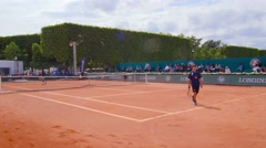 Paris. Young sportsmen play tennis by Eiffel Tower. Dolly, steadicam. Stock Footage