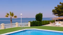 Typical townhouses, mediterranean residential complex, pool, panning. - stock footage