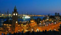 Landungsbruecken and the harbor at night in Hamburg, Germany. Stock Footage