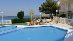Typical mediterranean residential complex with pool, dolly, steadicam. - stock footage