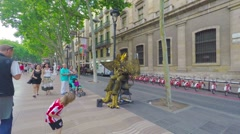 BARCELONA,  POV, walking on Rambla, live statues view, steadicam. Stock Footage