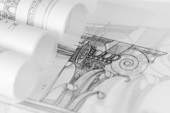 rolls of architecture blueprints - stock photo