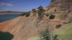 Shrinking lake Oroville exposes steep shoreline Stock Footage