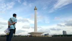 National Monument in Jakarta city against clouds timelapse Stock Footage