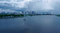 Dallas Skyline time lapse w/ super cell wide shot reflecting in River Stock Footage