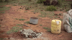 Man collecting rocks to make cement concrete, Africa, Kenya Stock Footage