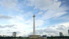Grey clouds and bluish sky over Monas, Merdeka Square, time-lapse shot Stock Footage