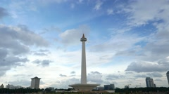 Dark clouds are gathering over the National Monument, Jakarta, long time-lapse - stock footage